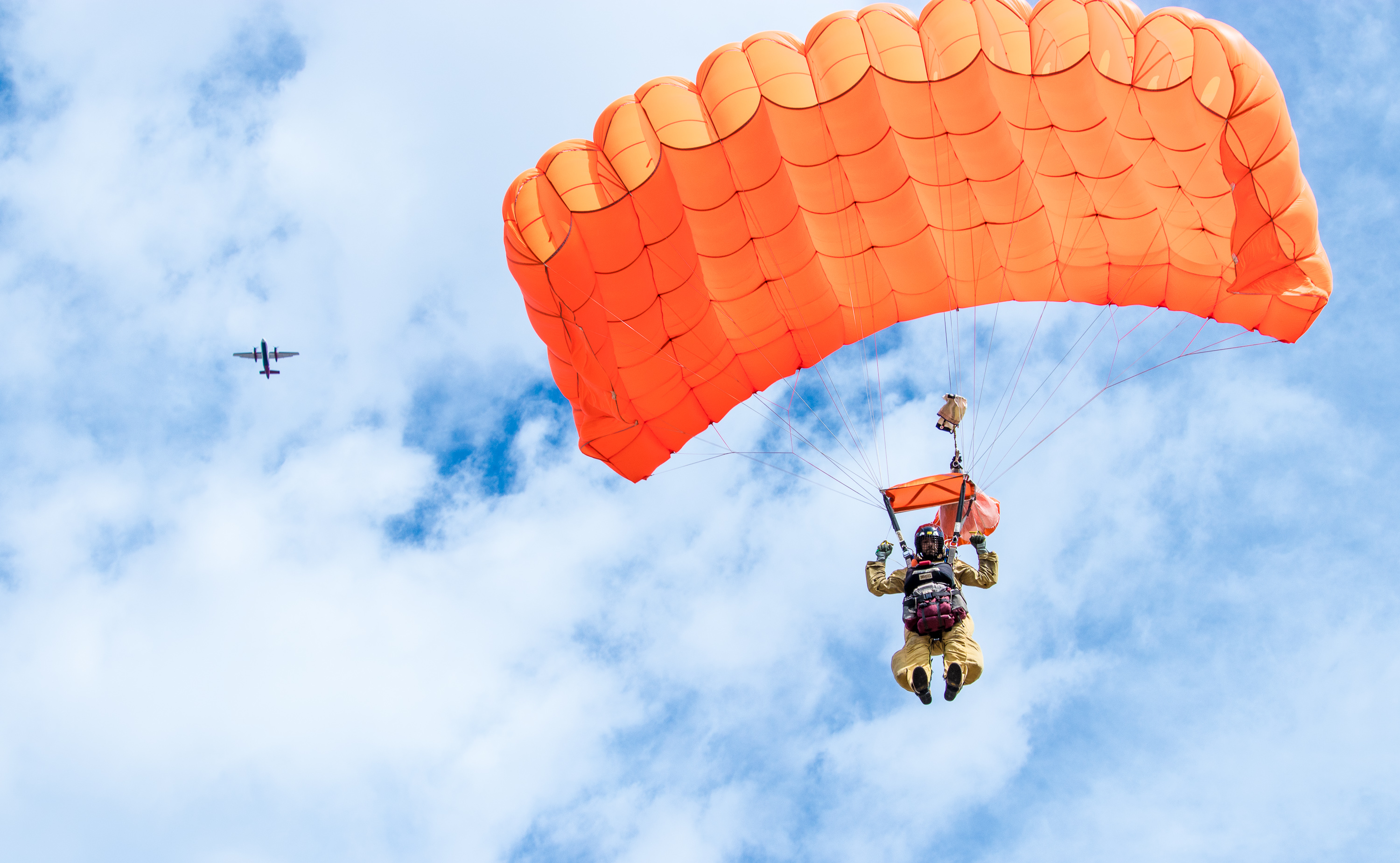A smokejumper lands during a training exercise.