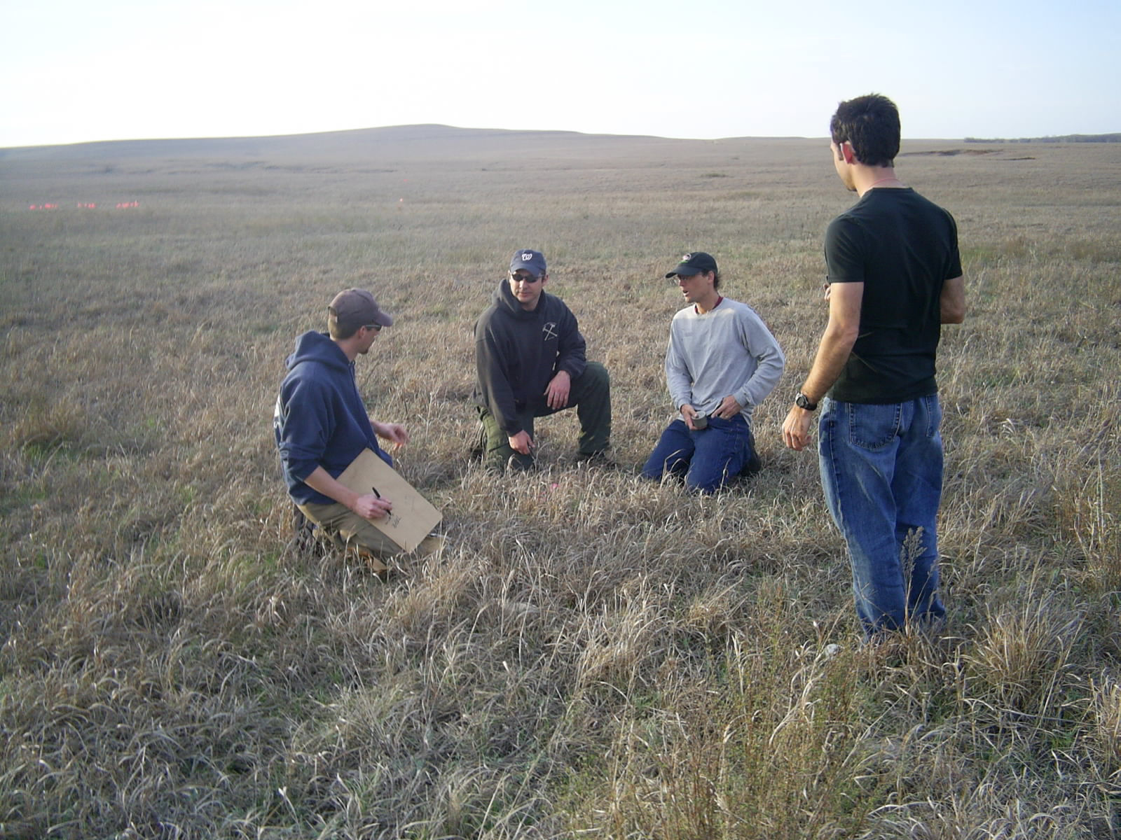 Joint Fire Science researchers discussing Big Pasture prescribed fire at Tallgrass Prairie National Preserve.